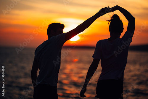 fototapeta na ścianę Romantic couple dancing on the street.Having a romantic date.Celebrating anniversary.Valentines day.Birthday date.Gentleman and lady.Manners.Treating the loved one.Dance,music,passion