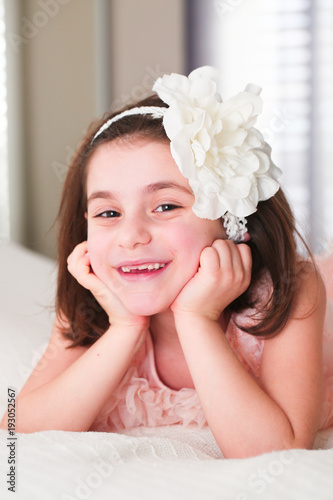 6 Or 7 Years Old X Girl With Dark Hair And Brown Eyes With White