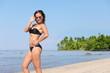 girl in bikini is resting on the sea