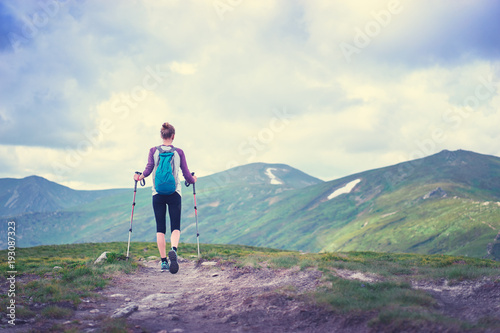 Active lifestyle. Traveling, hiking and trekking concept. Young woman with backpack in the Carpathian mountains.