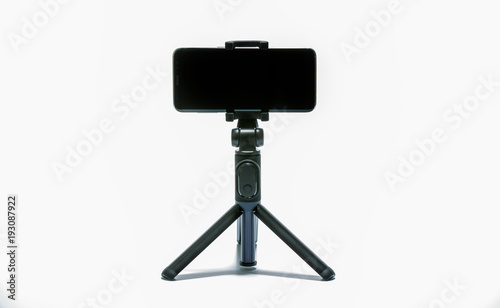 smart phone and tripod isolated on white background #193087922