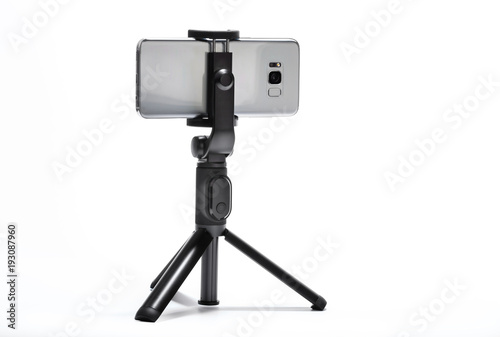 smart phone and tripod isolated on white background #193087960
