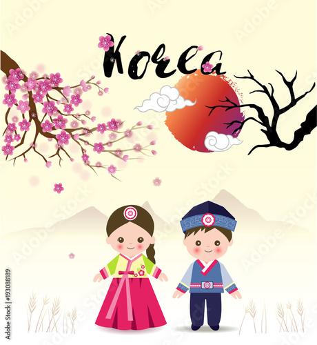 Cute girl and boy standing under sukura tree in korean traditional cute girl and boy standing under sukura tree in korean traditional costume with sun and mountain m4hsunfo