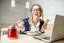 Businesswoman Enjoying Pasta M...