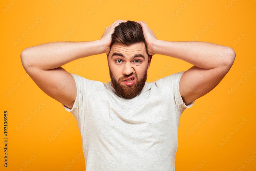 Fototapeta Portrait of a confused bearded man
