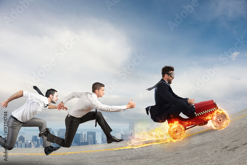 Fast businessman with a car wins against the competitors Wallpaper Mural