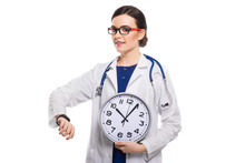 Young Woman Doctor With Stethoscope Holding Clock In Her Hands In White Uniform On White Background