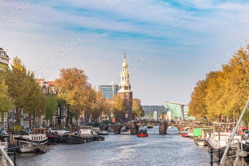 Poster Amsterdam Amsterdam sunset city skyline at Montelbaanstoren Tower, Amsterdam, Netherlands