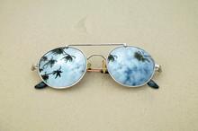 Mirrored Sunglasses Close Up O...