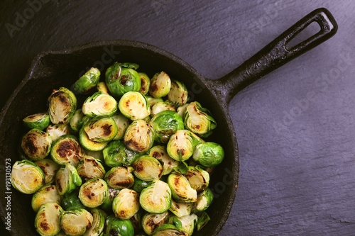 Tuinposter Brussel Vegetarian cuisine. Brussels Sprouts roasted with olive oil. Copyspace