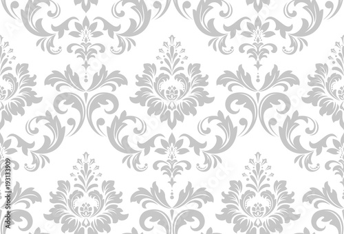 Fototapeta Wallpaper in the style of Baroque. A seamless vector background. White and grey floral ornament. Graphic vector pattern. obraz