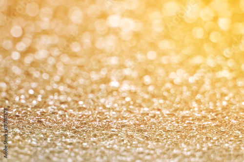 Abstract yellow bright background with glass bokeh with space for text