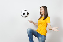 Beautiful European Young Woman, Football Fan Or Player In Yellow Uniform Juggling Bouncing Soccer Ball On Knee Isolated On White Background. Sport Play Football Health, Healthy Lifestyle Concept.
