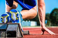 Runner Before Start Signal On Starting Block Of Sprint Track In Sport Stadium