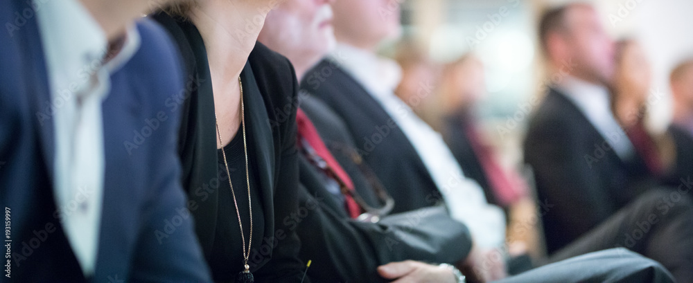 Fototapety, obrazy: Row of unrecognizable business people sitting in conference hall at business event. Audience at business seminar. Business and Entrepreneurship concept.