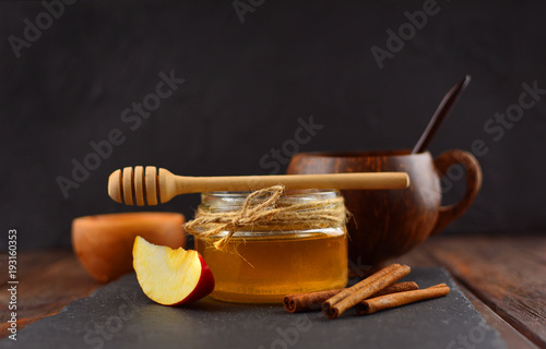 Beautiful honey on a rustic wooden table Wallpaper Mural