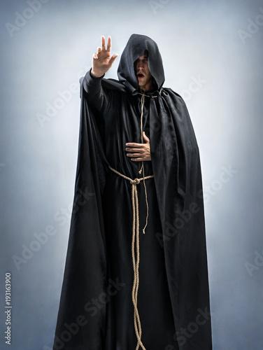 Obraz na plátně Monk preaches or reads a prayer