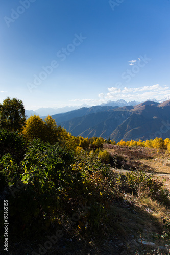 Foto op Canvas Zwart Colorful beautiful autumn landscape with snowy mountains in Svaneti. Georgia