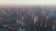 Shanghai Skyline in the Sunny Morning. Puxi District. China. Aerial View. Drone is Flying Forward. Establishing Shot..