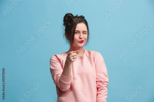Fotografía  The happy business woman point you and want you, half length closeup portrait on blue background