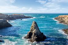 Single Rock In A Blue Ocean