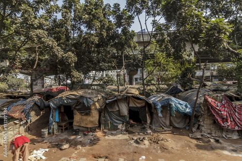 Photo Dhaka / Bangladesh - November 2012: People live in slums just off the tracks in Dhaka Bangladesh