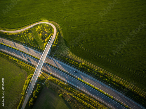 In de dag Luchtfoto Aerial view of a highway amid fields with cars on it
