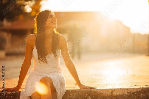 Carefree woman enjoying in nature,beautiful red sunset sunshine.Finding inner peace.Spiritual healing lifestyle.Enjoying peace,anti-stress therapy,mindfulness meditation.Positive energy.Freedom