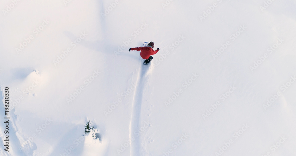 Snowboarding Overhead Top Down View Of Snowboarder Riding