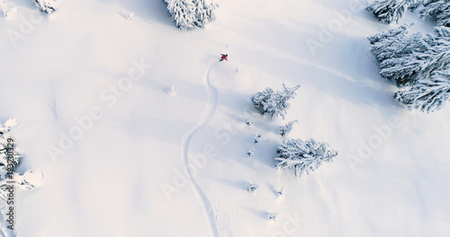 Spoed Foto op Canvas Wintersporten Snowboarder Drone Angle Powder Turns Fresh Untracked Mountain Powder Snow Aerial View