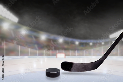 Outdoor Hockey Stadium With Stick and Puck on Ice
