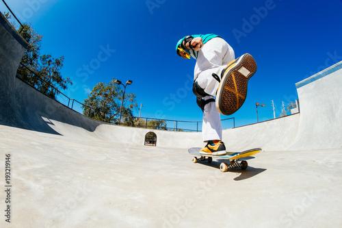 Fotografie, Obraz  young skateboarder at a park