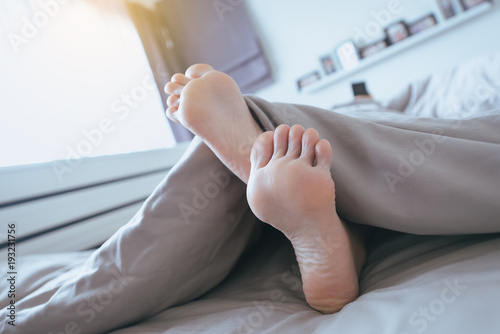 Fototapeta Close up of  barefoot,Feet and stretch lazily on the bed after waking up obraz na płótnie