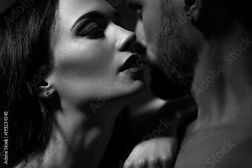 Fototapeta Black and white image of loving couple. Going to kiss. obraz