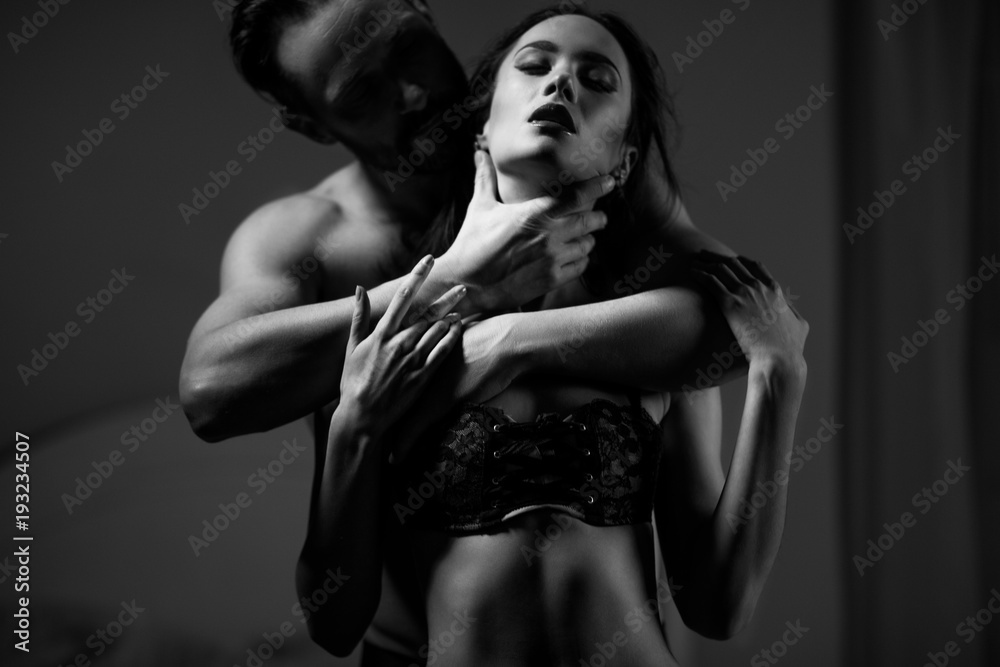 Fototapeta attractive belovers in underwear. Black and white close-up of a man and a woman. passion concept