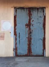 Rusty Locked Metal Factory Door