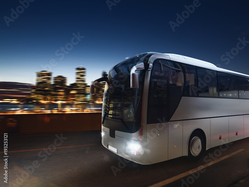 Fotografie, Obraz  Bus on the road at night with city landscape. 3D rendering