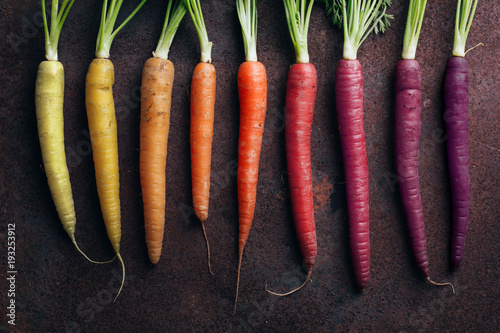 Tuinposter Eten Close up of carrots arranged against gray background
