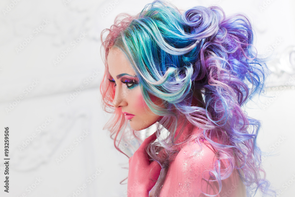 Fototapeta Beautiful woman with bright hair. Bright hair color, hairstyle with curls.