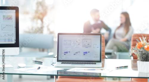 Fotografie, Obraz  monitors on the desktop in a modern office.business background.