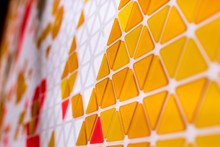 Tessellation Of A Plane With Yellow, Orange And Red Colored Triangles On A White Background. Mathematical And Artistic Game To Cover A Surface With Geometric Shapes. Triangles In Sequence As A Code