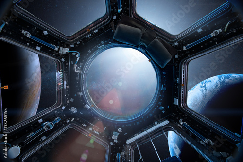 Wall Murals Nasa View from a porthole of space station on the Earth background. Elements of this image furnished by NASA.