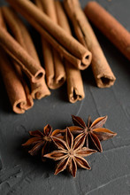 Shelves Of Cinnamon And Anise Stars In Dark Colors On A Dark Concrete Stone Background