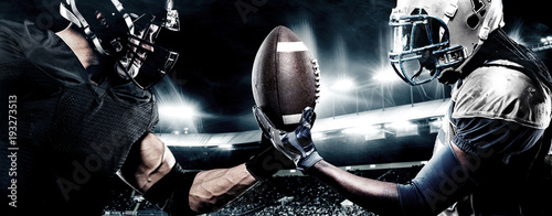 Two american football sportsman players on stadium Canvas Print