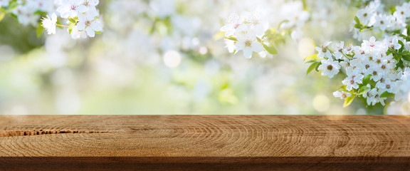 Spring flowers in a park with rustic wooden table