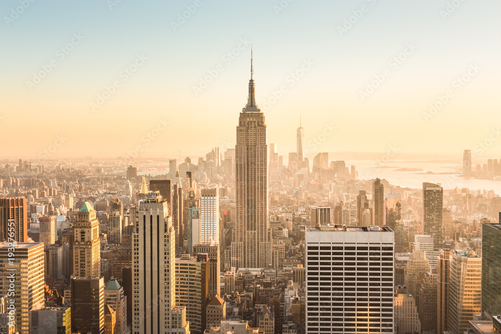 Fototapety, obrazy: New York City. Manhattan downtown skyline with illuminated Empire State Building and skyscrapers at amazing golden sunset. USA.