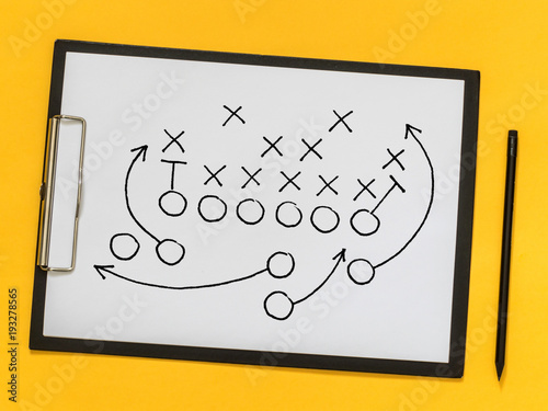 American football strategy, coaching, training. Game strategy. Scheme of the game on a sheet of paper