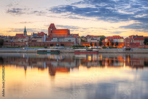 Torun old town over Vistula river at sunset, Poland