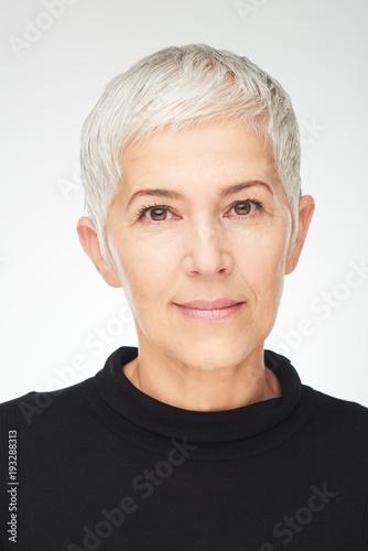 Fotografia  Portrait of beautiful senior woman in front of white background.