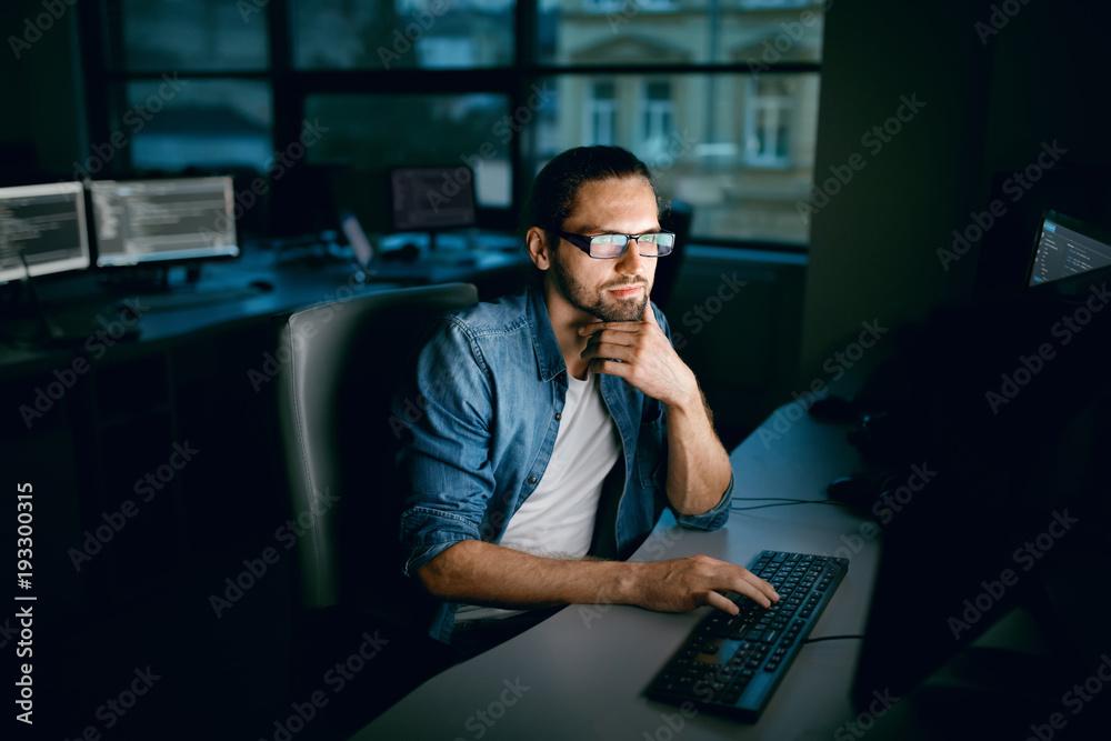 Fototapeta Programming. Man Working On Computer In IT Office